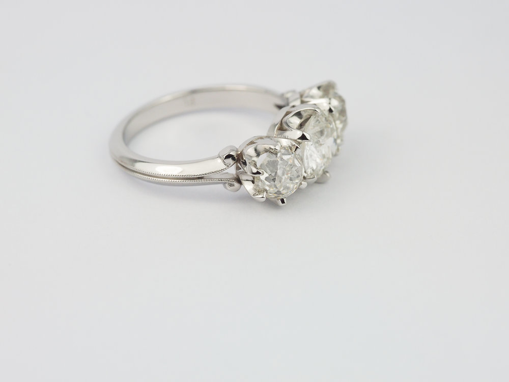 Old cut diamond three stone platinum engagement ring