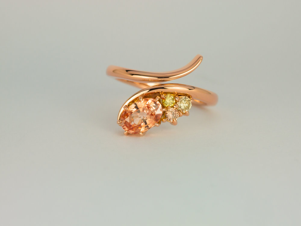 Padparadscha sapphire and coloured diamond rose gold engagement ring