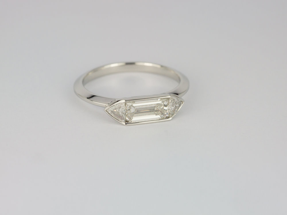 Emerald cut and trilliant cut diamond engagement ring