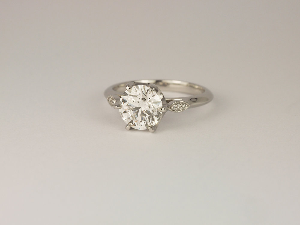 Platinum diamond engagement ring with millegrain detail