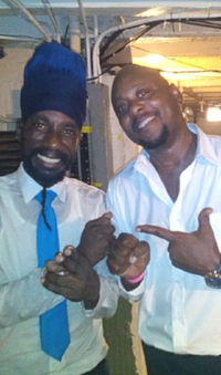 Sizzla and Carradice's   father,  Poppa Mikey
