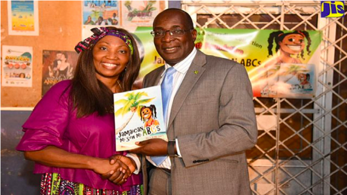 Minister of Education, Youth and Information, Senator Ruel Reid, with author of the book, 'Jamaican Mi Seh Mi ABCs', Valrie Kemp-Davis, at the recent launch, held in the August Town community of St Andrew