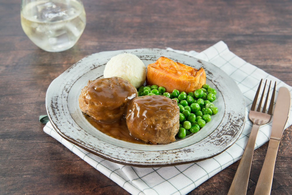143. Beef Rissoles with Onion Gravy served with potatoes, pumpkin and peas in a lemon, garlic dressing