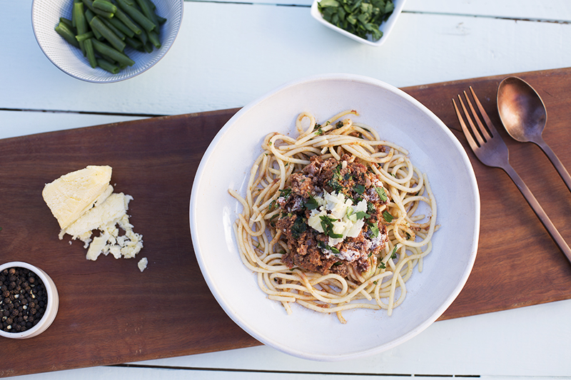 141. Spaghetti Bolognese served with green baby beans, parsley and parmesan cheese