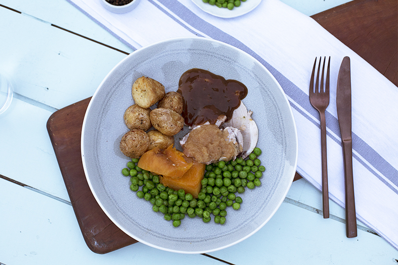 154. Roast Pork With Apple Sauce served with potato, pumpkin, peas with a lemon, mint dressing