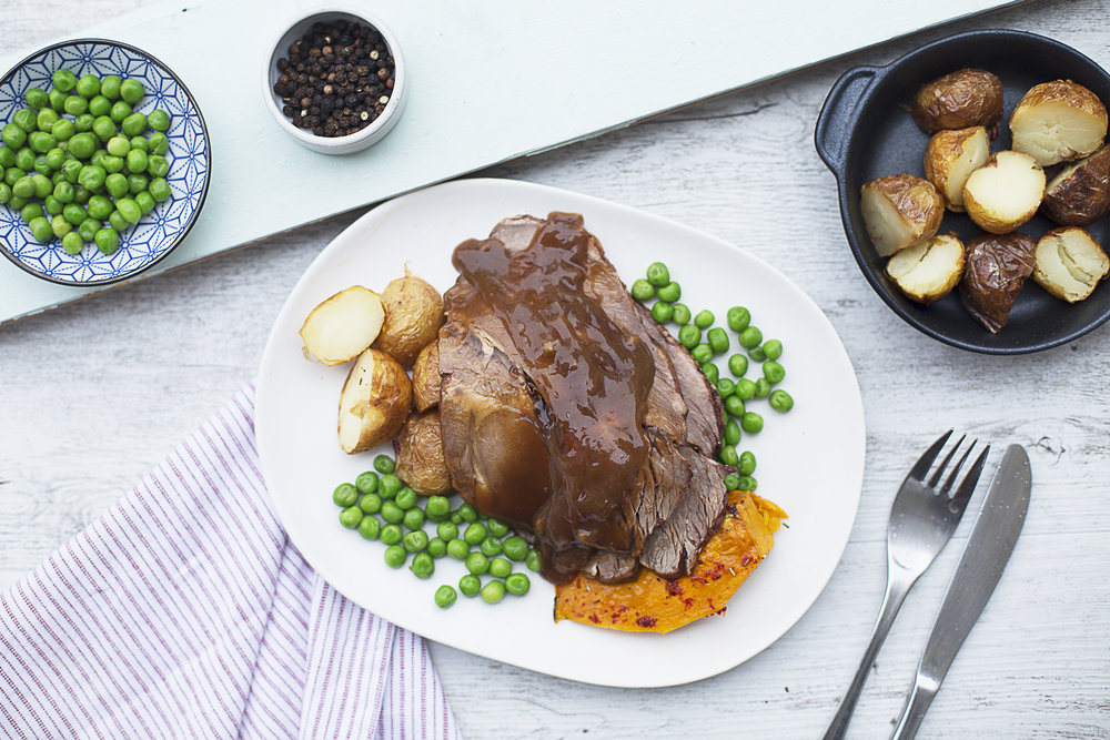 158. Roast Lamb with mint gravy, served with roasted potatoes and peas, corn and carrots
