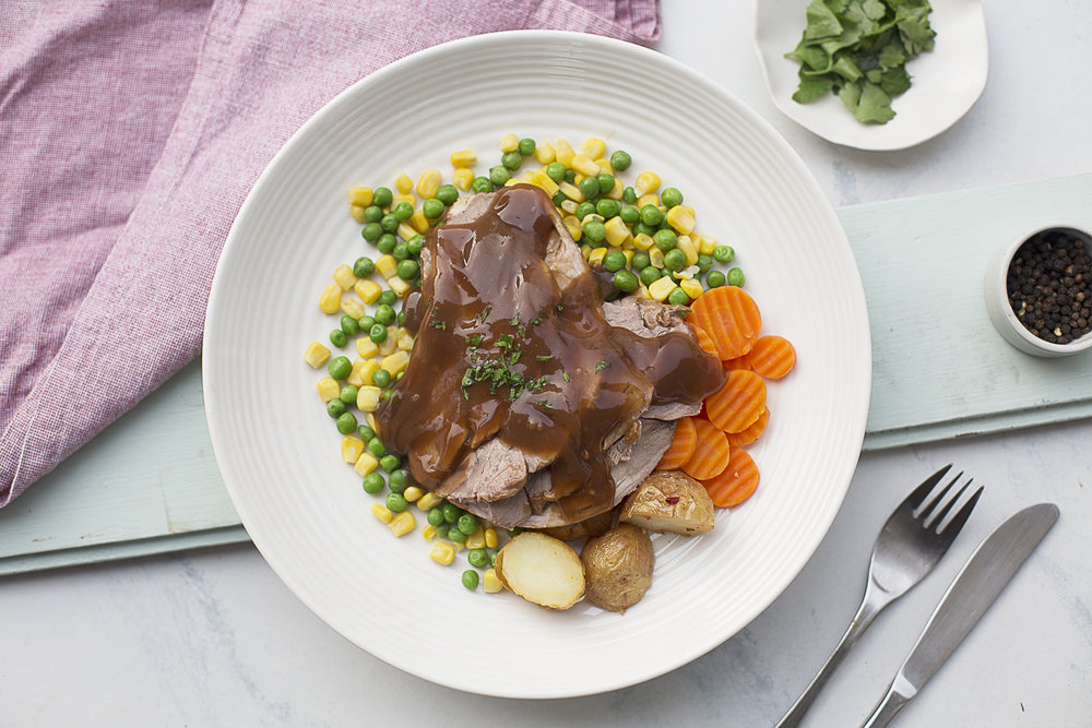 140. Roast Beef with Gravy served with roasted potatoes, pumpkin, peas and lemon herb dressing