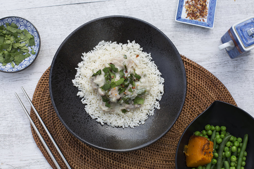 149. Thai Green Chicken Curry served with rice, pumpkin, baby green beans and peas