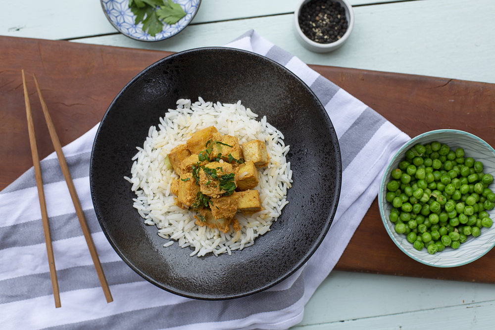198. Tofu Yellow Coconut Curry served with rice and peas