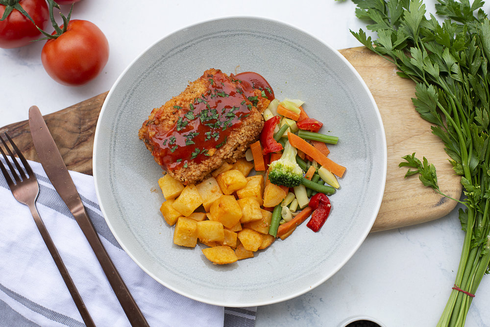 197. Marinated Tofu Schnitzel dressed with sweet chilli sauce served with roast potatoes and vegetable medley
