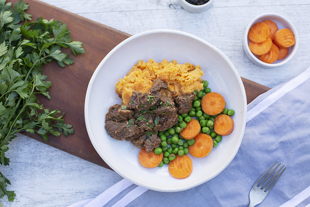 1007. Braised Country Beef served with a creamy sweet potato mash, sliced carrot and green garden peas