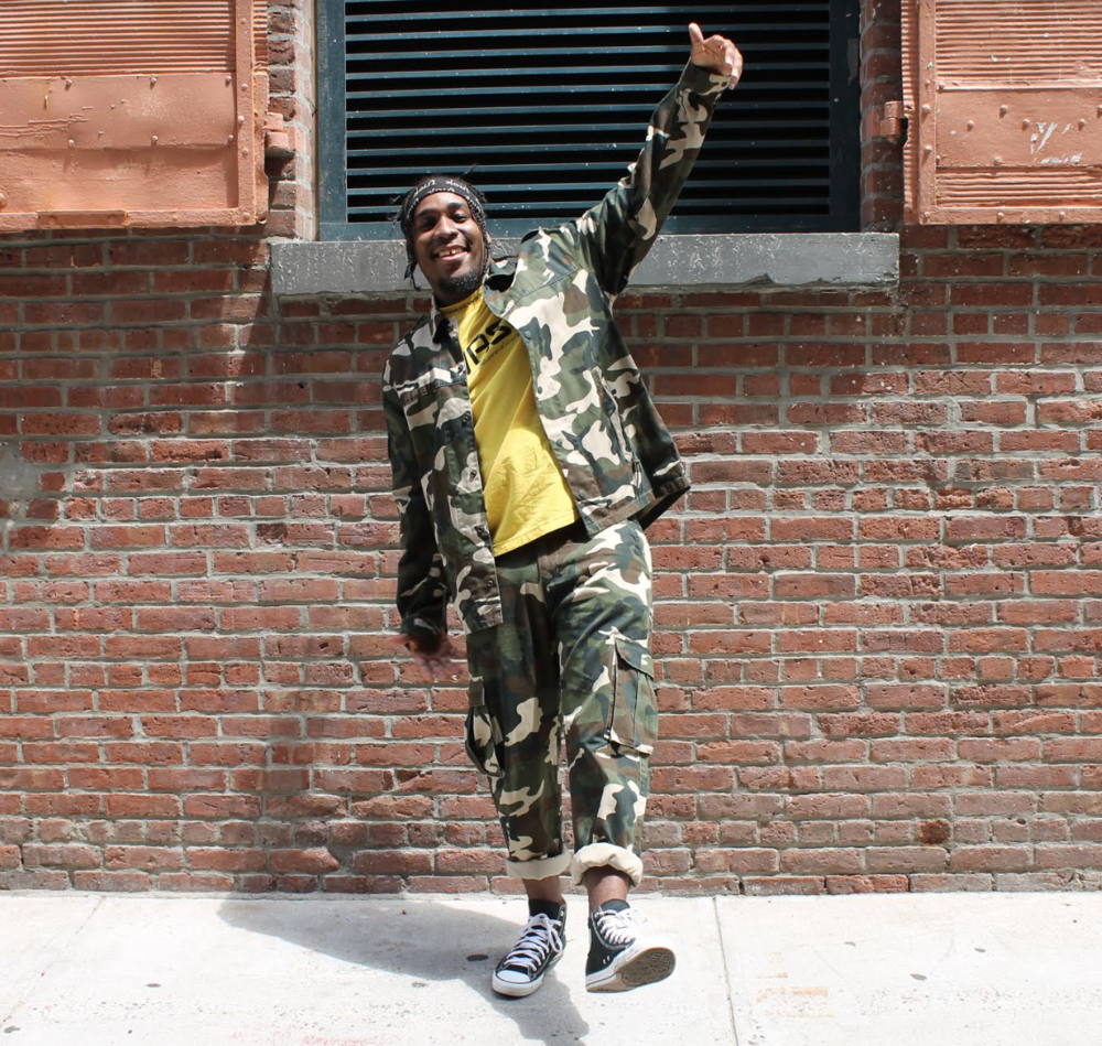 Kay sports the Wallace pant and Freddy jacket camo set from WeSC.
