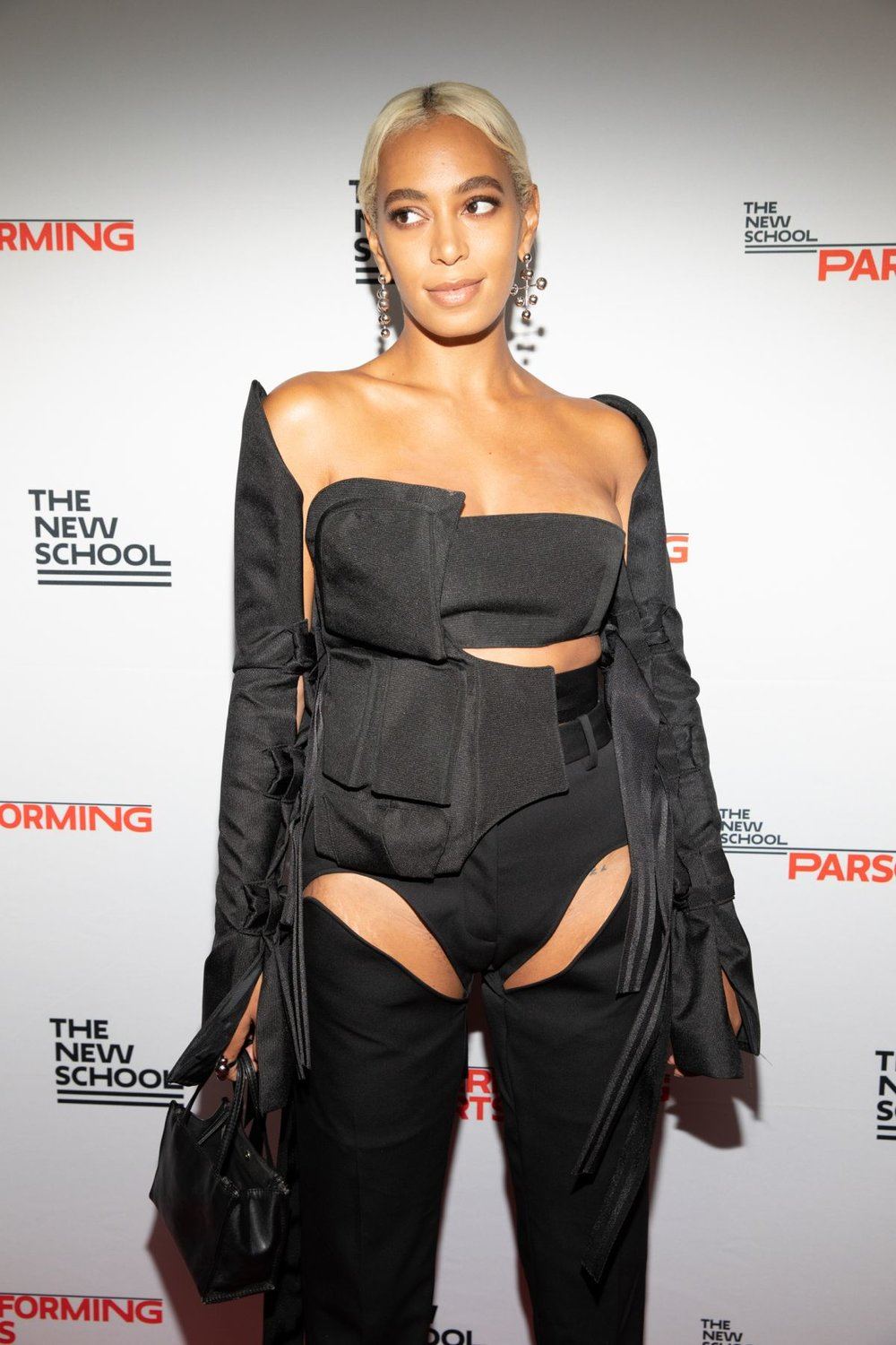 Soalnge Knowles wearing Shanel Canvas Body Bag, Bandeau, and Strap on Sleeves