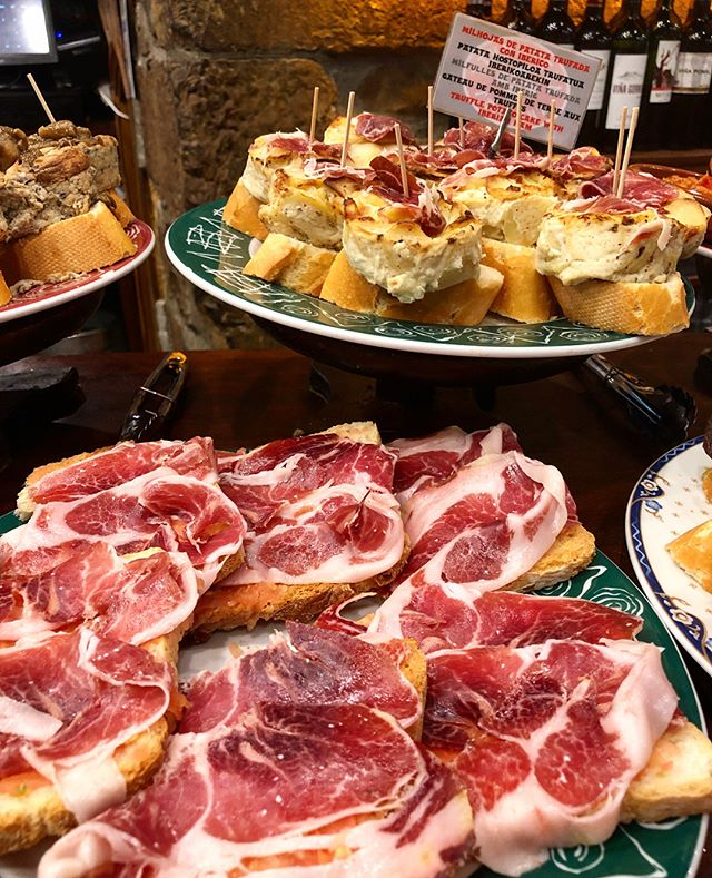 San Sebastián really is food heaven. If you're like me and want to try 12,345 different things in one sitting then this is the place for you. Pintxos are some plates that are served everywhere in the lanes of central SAN Sebastián. Strewn across the bar, this delicious little bites are the perfect opportunity to try everything the city has to offer! #SanSebastian #BasqueCountry #Pintxos #Spain #Food #Foodie #Travel #eeeeeats #delicious #instalike #londonfoodie #f52 #feedfeed #thefeedfeed #onmytable #foodphotography #instagood #Instafood #HuffPostTaste #BuzzfeedFood #GoodFood #EatWell