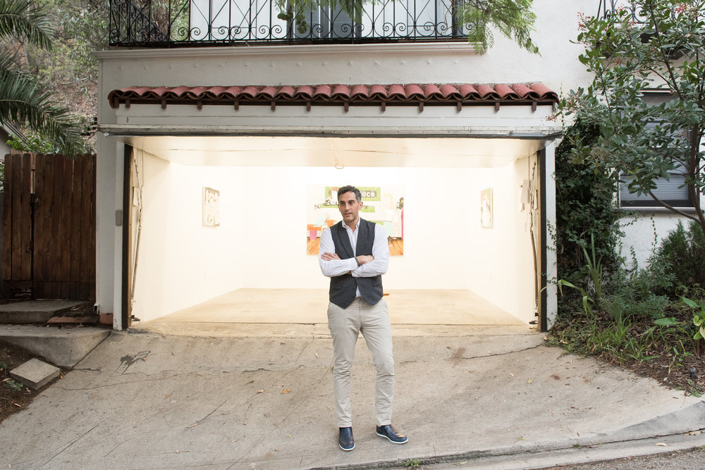 Robert Norton in front of his garage-turned-gallery at his home in LA.