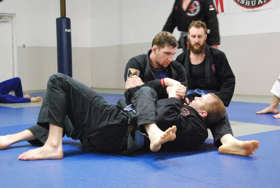 A student demonstrates an arm bar.