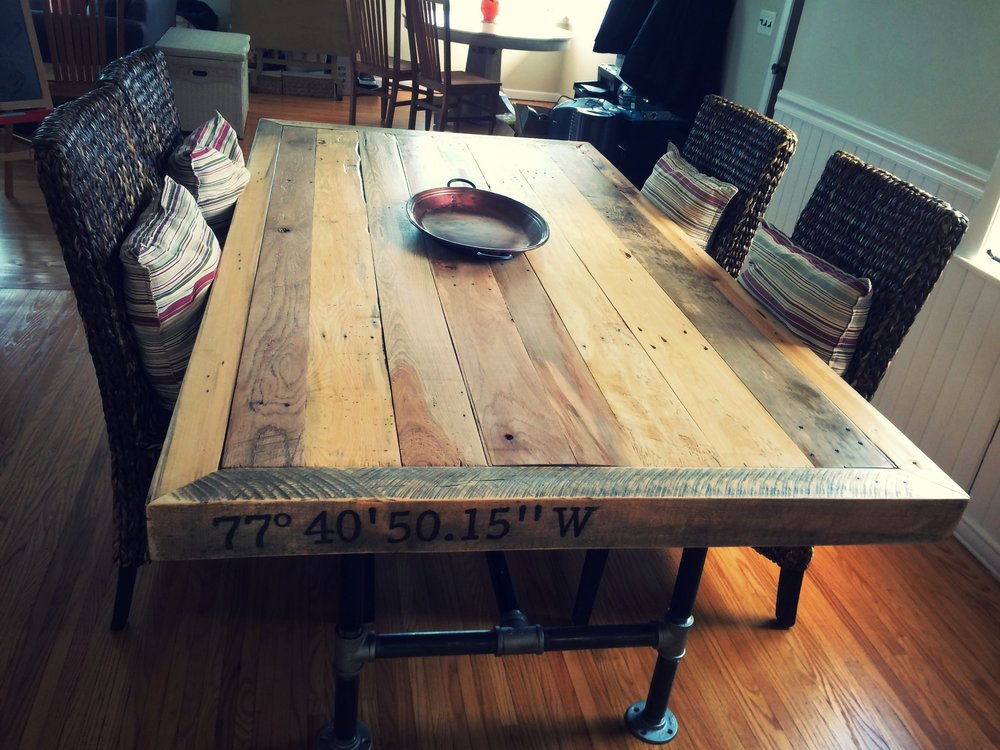 Reclaimed wood and pipe leg table with custom stamped lattitude and longitude