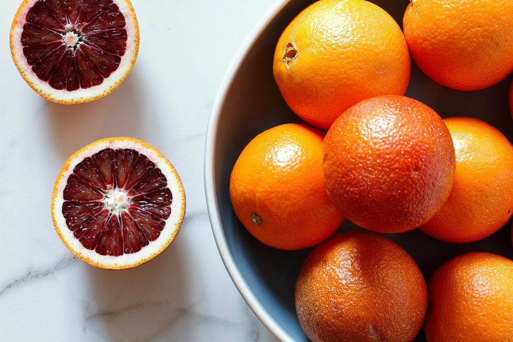 Blood and Cora Cora oranges in blue bowl.