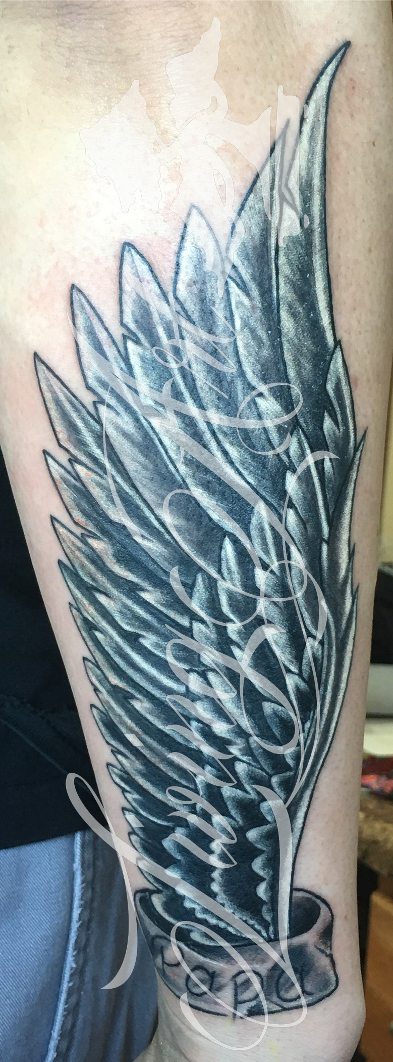 josh kirkpatrick tattoo_wing tattoo copy.jpg