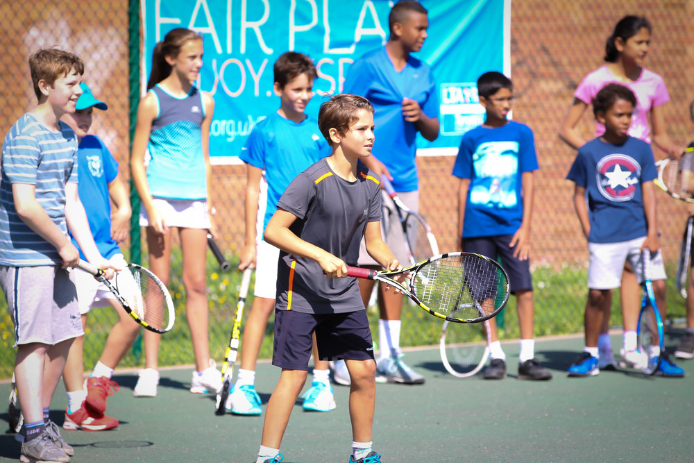 Free Junior Tennis & Games! While you relax at the bar....