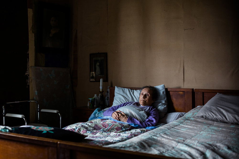 CONSTANZA HEVIA  www.constanzahevia.com  |  @constanzaheviah   Wilma Bahamonde rests on her bed at her rural home in the town of Las Cascadas in Chile on January 2, 2018. Hugo Küschel, her husband, used to sleep on the other bed. He passed away on September 7, 2017. Wilma still asks for him.