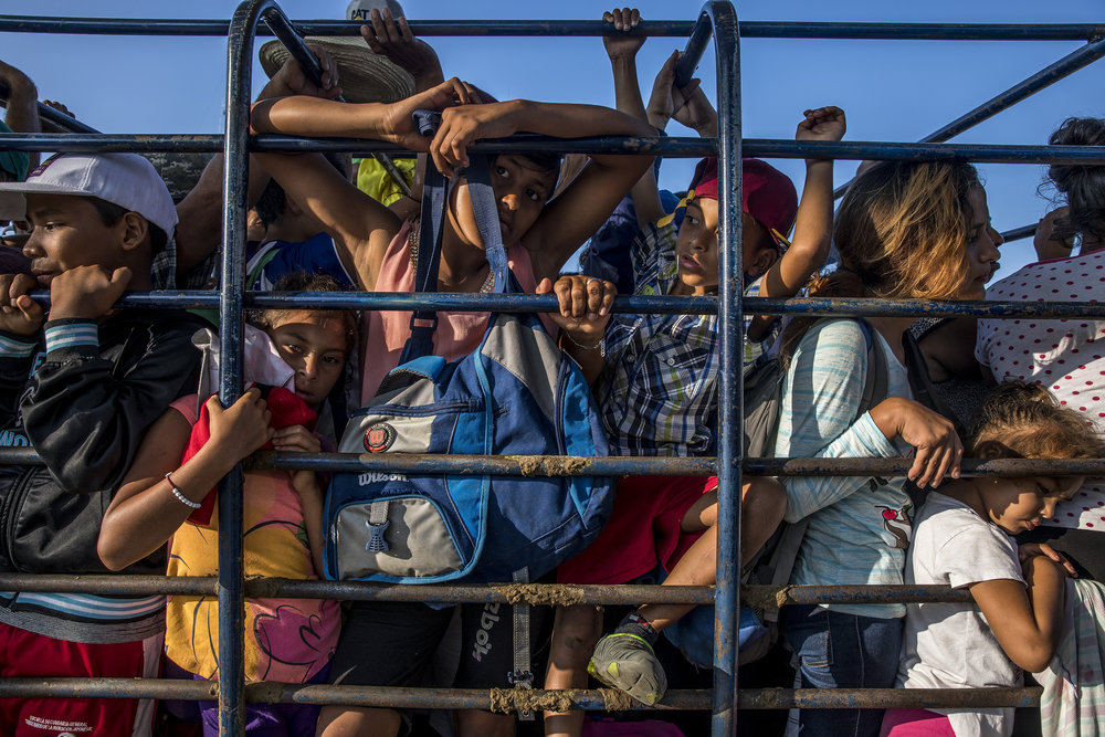 ADRIANA ZEHBRAUSKAS  www.azpix.com.br  |  @adrianazehbrauskas   Central American migrants pile into a truck on October 25, 2018 on the road from Pijijiapan to Arriaga, their next stop in the southern Mexican state of Chiapas, on their journey north towards the U.S. border.  From The New Yorker:    The Migrant Caravan Reaches a Crossroads in Southern Mexico   .