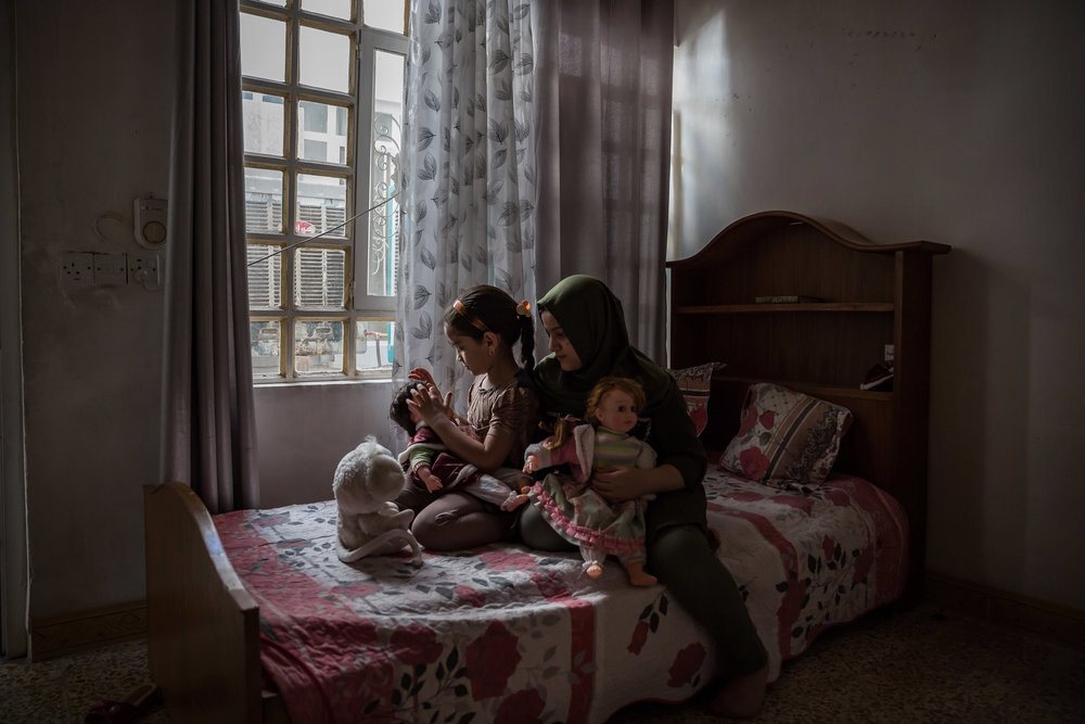 ANDREA DICENZO  www.andreadicenzo.com  |  @andreadicenzo   Sisters Maram, 9, and Rayam Sultan, 12, at their home in east Mosul, Iraq. The children's father was in the Iraqi security forces and killed by the Islamic State in 2014 after the group entered Mosul.   From The New York Times:    Iraq's Forgotten Casualties: Children Orphaned in Battle With ISIS