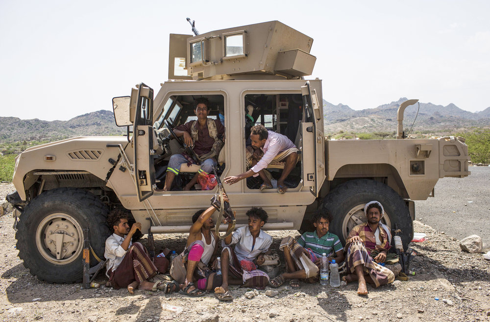 ASMAA WAGUIH  www.asmaawaguih.com  |  @asmaawaguih   Members of the Saudi-backed Yemeni forces chew Qat, a stimulant flowering plant, while resting around a military vehicle as they advance in Al-Wazeya area in Taiz governorate against Houthis fighters on May 13, 2018.