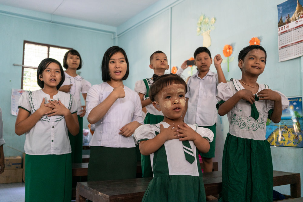 CHIARA LUXARDO  www.chiaraluxardo.com  |  @chiaraluxardo   Children practice singing and dancing with a professor in deaf education at the Yangon School for the Deaf in Myanmar.