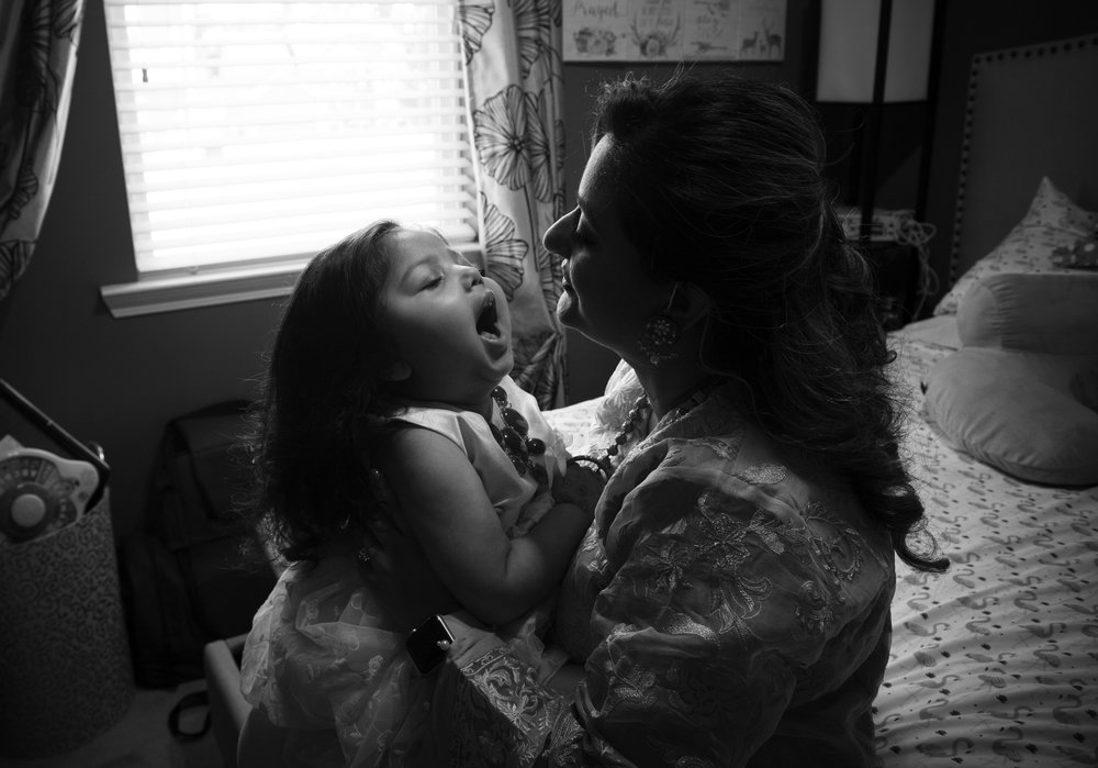 "ROBIN RAYNE  www.creativerayne.com  |  @robin.rayne   Gul Kahn holds her terminally-ill daughter Sareena on her third birthday – which would be her last. Gul and her husband Amir fought the state system's rules which limited the hours of skilled in-home nursing care her dying daughter could receive. ""We wanted to give her the best life possible at home with us, not an institution like the state wanted,"" she said. Medicaid funds for Sareena's nursing care was radically cut two years ago, despite her 24-7 care needs. The cutback forced Gul to leave her job as a state engineer to care for her and the family lost their health insurance as a result. Sareena died in October, 2018. ""Sareena was a blessing from God, and He has taken back his gift,"" she said."