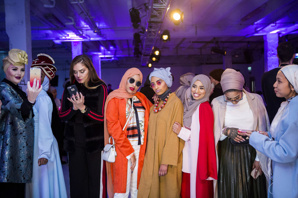 NATALIE NACCACHE  www.natnacphotography.com  |  @natnacphotos   Attendees pose for cameras before a fashion show at London Modest Fashion Week on February 17, 2018.  From The Washington Post:    The Big Business of Modest Fashion