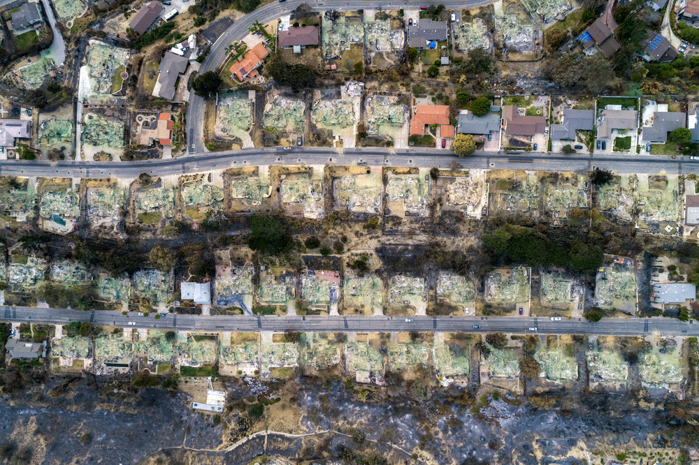 KERI OBERLY  www.kerioberly.com  |  @kerioberly   An aerial view of a section of the Ondulando neighborhood on Monday, January 1, 2018, after the second largest wildfire in California history burned through Ventura, CA. Powered by Santa Ana winds and a multi year drought, the Thomas Fire burned 281,893 acres, destroyed 1,063 structures, displaced over 100,000 residents, caused two deaths, saw 8,500 firefighters, and caused over $2.2 billion in damages, during the 40 days it was active. The 2018 wildfire season was the most destructive and deadliest in California history.