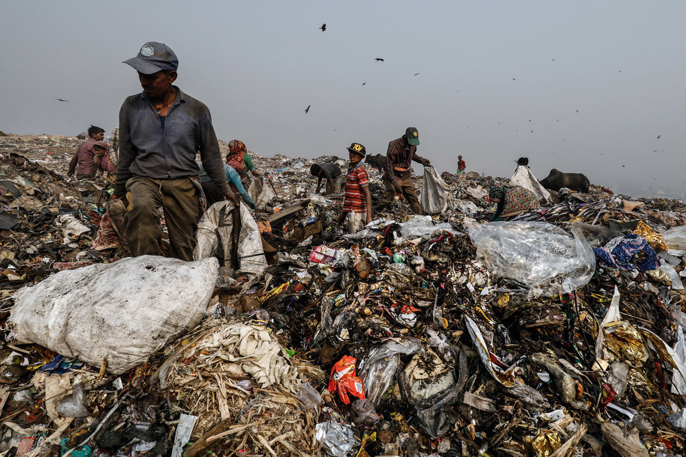 SAUMYA KHANDELWAL  www.saumyakhandelwal.com  |  @khandelwal_saumya   People segregate waste atop a mound of garbage at Bhalswa landfill in New Delhi, India on May 6, 2018.  From The New York Times:    'The Dump Killed My Son': Mountains of Garbage Engulf India's Capital