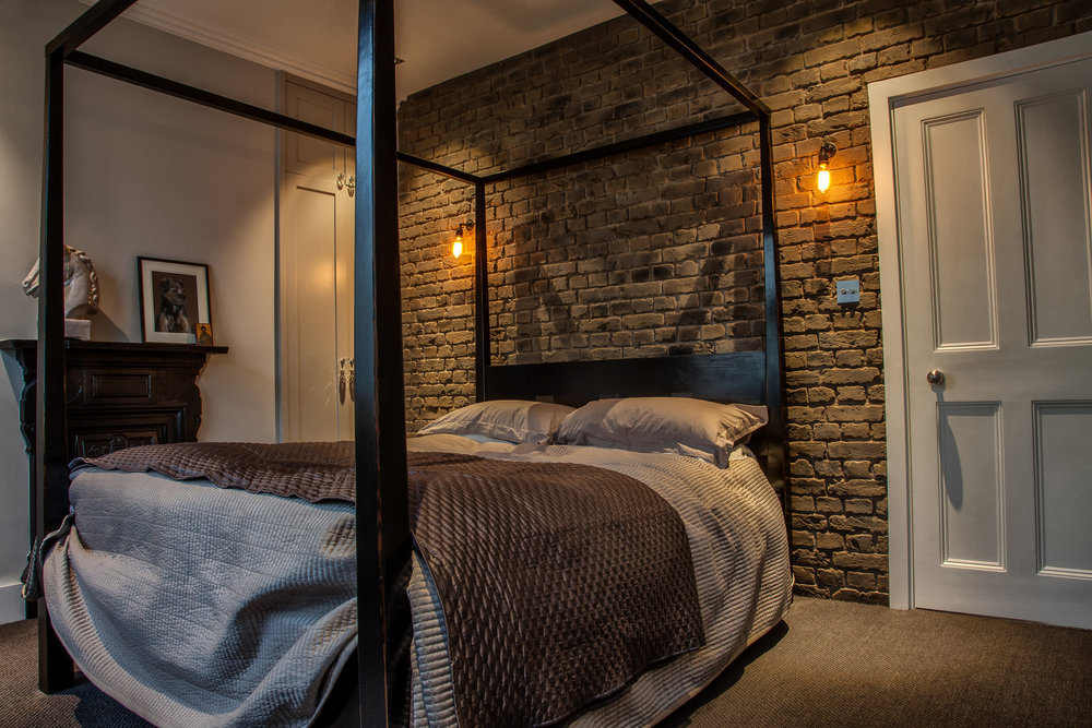 Bedroom with Faux brick panels