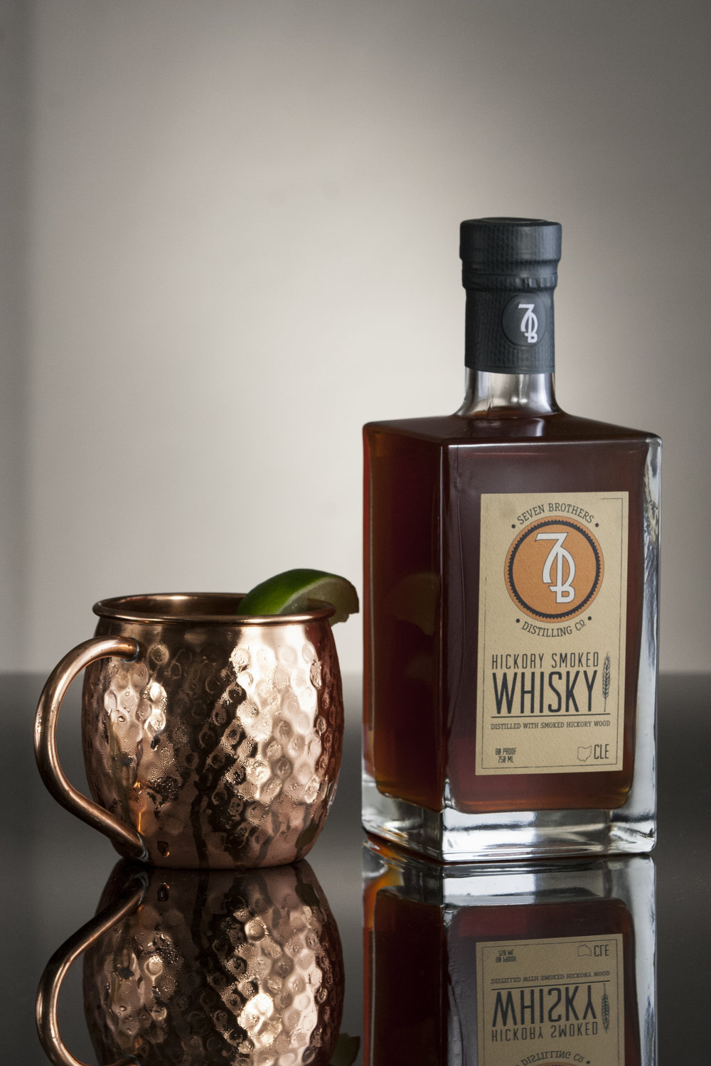 SMOKED BUCK - 2 oz Seven Brothers Hickory Smoked Whisky1.5 oz Ginger Beer3/4 oz Lime Juice3/4 oz Simple SyrupShake over ice, and strain into a Copper Mug. Garnish with a lime wheel.