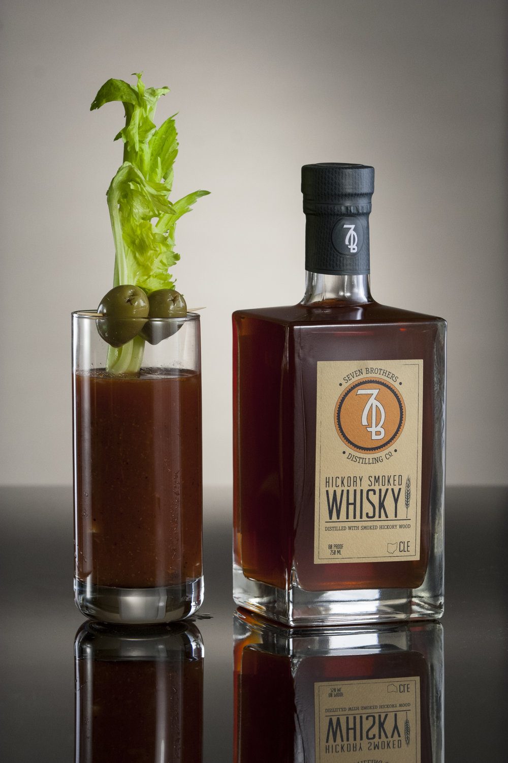 BROTHERS BLOODY MARY - 2 oz Seven Brothers Hickory Smoked Whisky4 oz Bloody Mary mix2 dash Tobasco sauce2 dash Worcestershire sauce.5 oz Lemon Juice1 pinch Black Pepper1 pinch SaltShake over ice, and strain into a Highball glass. Garnish with a celery stalk, lime wedge and olives.