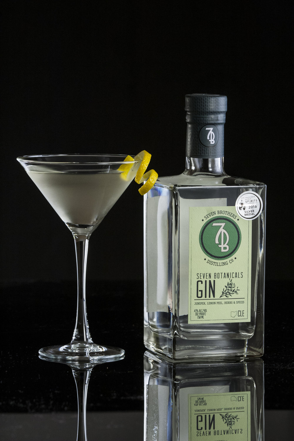 7B MARTINI - 3 oz Seven Brothers Seven Botanicals Gin1 oz Dry Vermouth1 dash Orange BittersStir ingredients over ice and strain into a Martini glass. Garnish with a lemon twist.