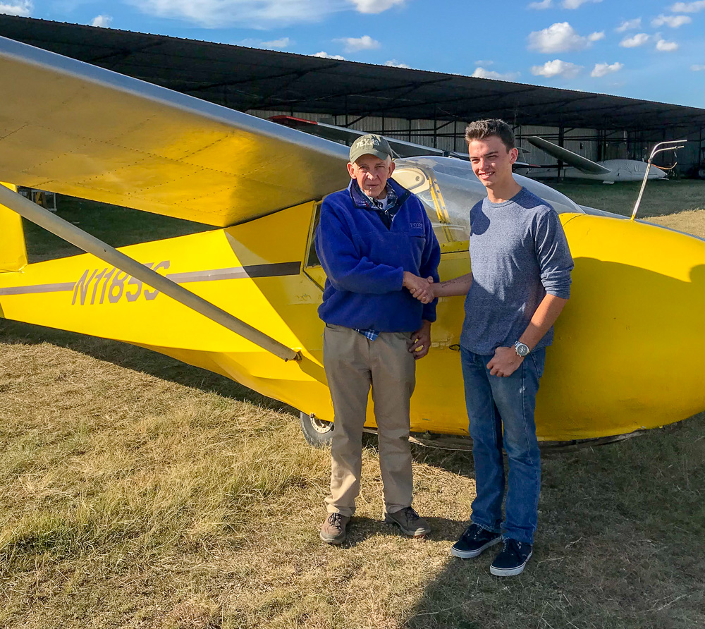 Dak Davis  (on the right in the photo), all of 20 years old and a member of the Greater Houston Soaring Association in Walls Texas, is now an FAA Certified Flight Instructor - Glider! He passed his CFI-G practical test On November 17, 2018 with Designated Pilot Examiner Gregg Squires (left) at Fault Line Flyers in Bertram, Texas. Dak now holds a commercial glider rating, an advanced ground instructor rating and a CFI-G rating. Congratulations to Dak on this huge accomplishment.  This brings Greater Houston Soaring Association's instructor corps to 11 instructors!