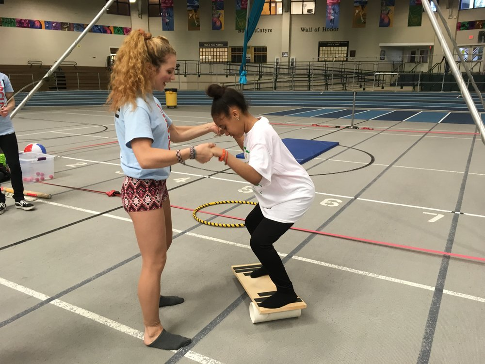 Circus Up Volunteer Sophia Thurau-Gray teaches rolla bolla at a recent Boston Celtics Outreach day!