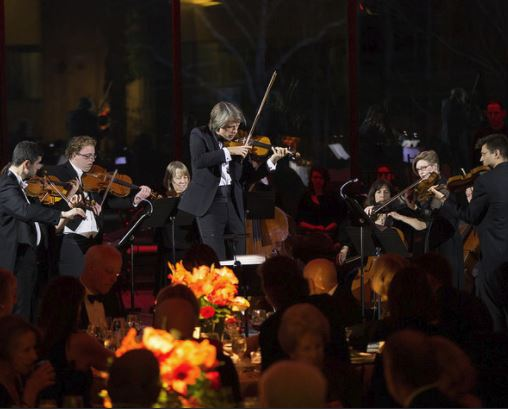 Violinist Daniel Rowland performs with PSO musicians at the PSO's 2017 Gala, Under the Stars in Buenos Aires.