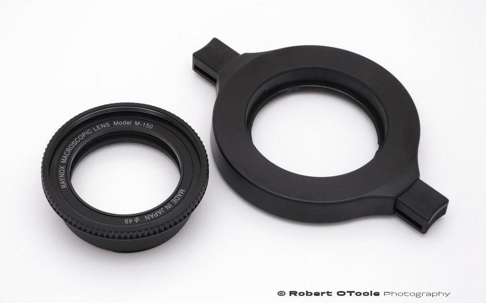 This is the supplied Raynox adjustable adapter and DCR-150 also known as the Model M-150 lens.