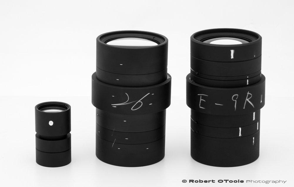The 3 versions of the Scanner Nikkor ED lens, L-R, the 7 element Scanner Nikkor ED lens, the 14 element Scanner Nikkor ED lens from the 8000 scanner and the 14 element Scanner Nikkor ED lens from the 9000 scanner.