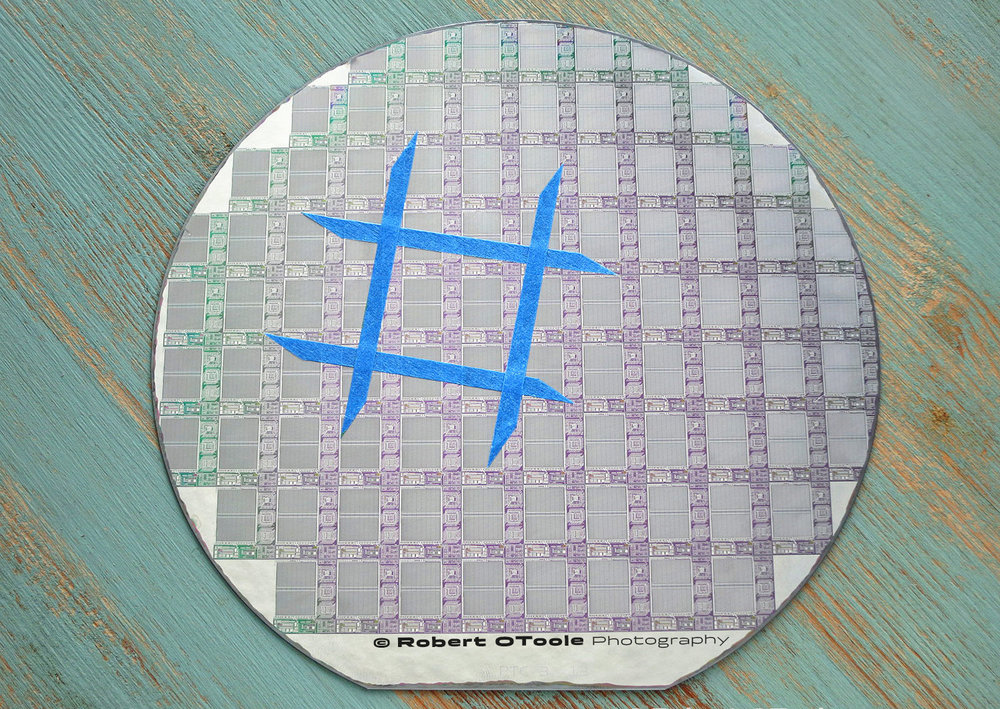Wafer with 1X test area outlined with blue tape.
