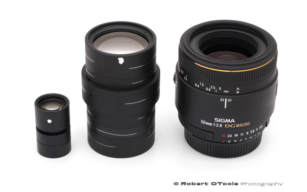 Scanner Nikkor ED 7 Element lens, Scanner Nikkor ED 14 element lenses from the Super CoolScan 8000 ED scanner and the Sigma 50mm f/2.8 macro lens for scale.