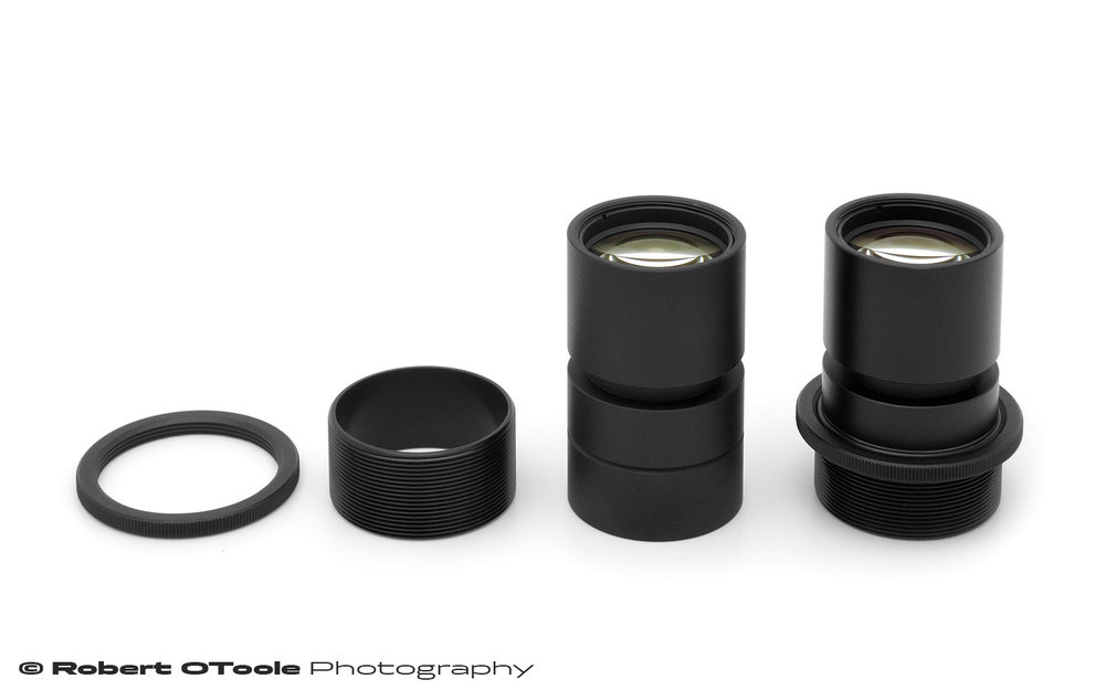 Scanner Nikkor 7 element bare lens with Thorlabs SM1 parts laid out and installed.