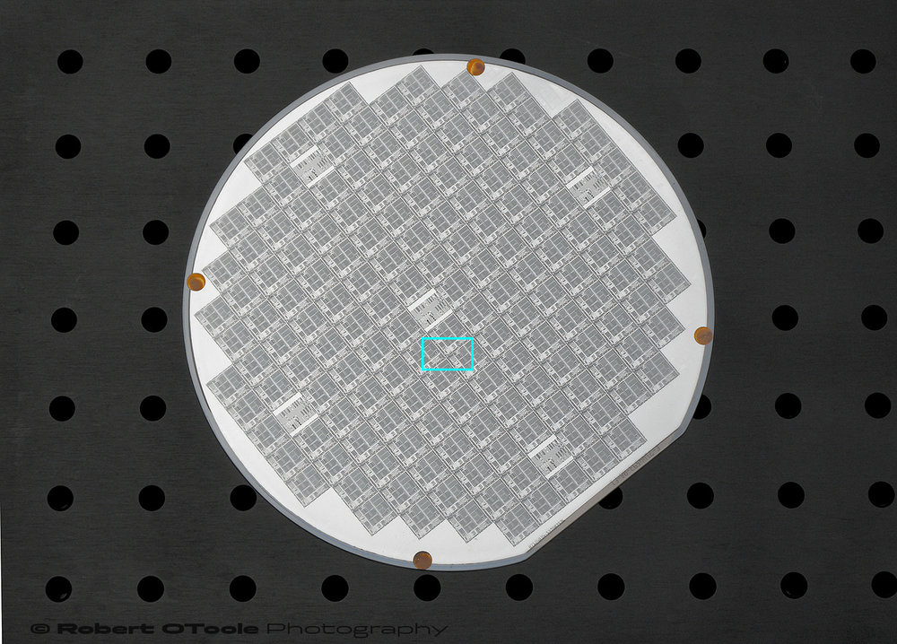 Vintage silicon wafer with the 1.2x magnification area marked in blue.