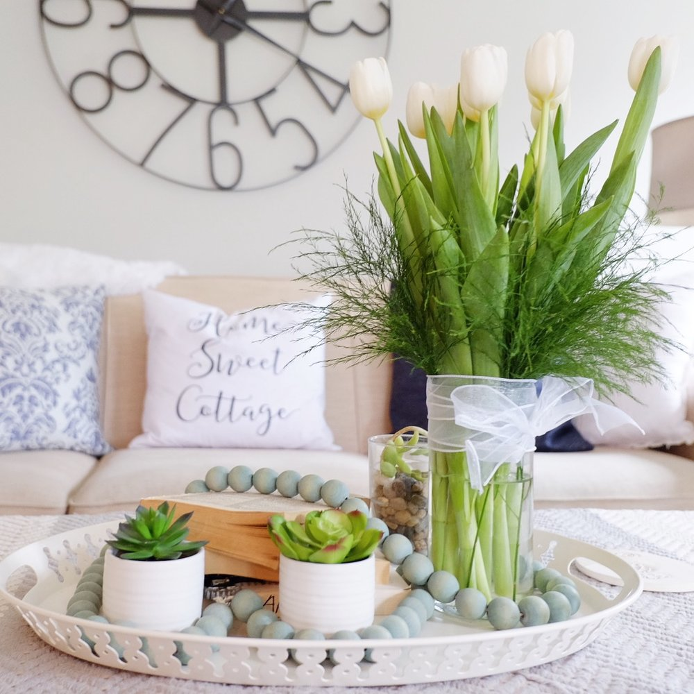Tulips in a tray with succulents make a great spring centerpiece.