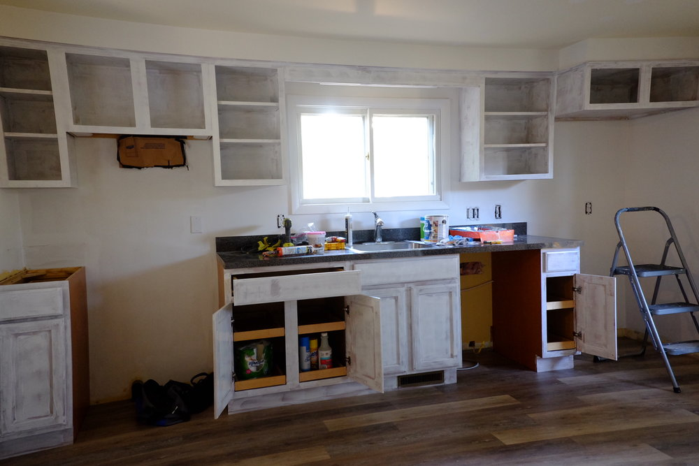 We primed and painted these cabinets and put a new floor in.