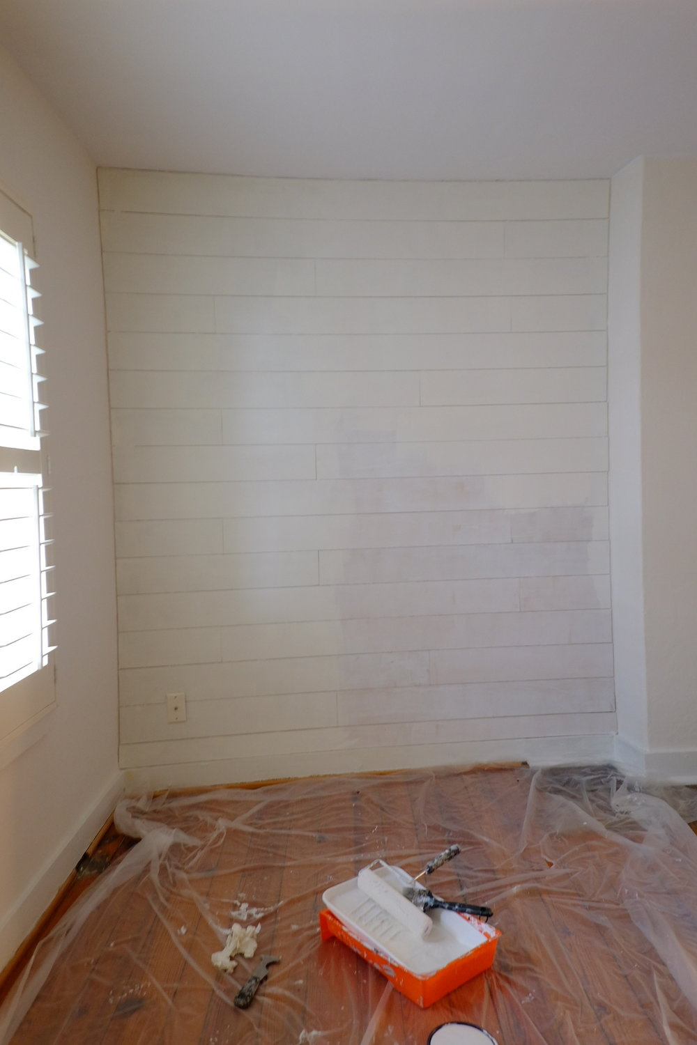 Added faux shiplap to the back wall to cover up the plaster.