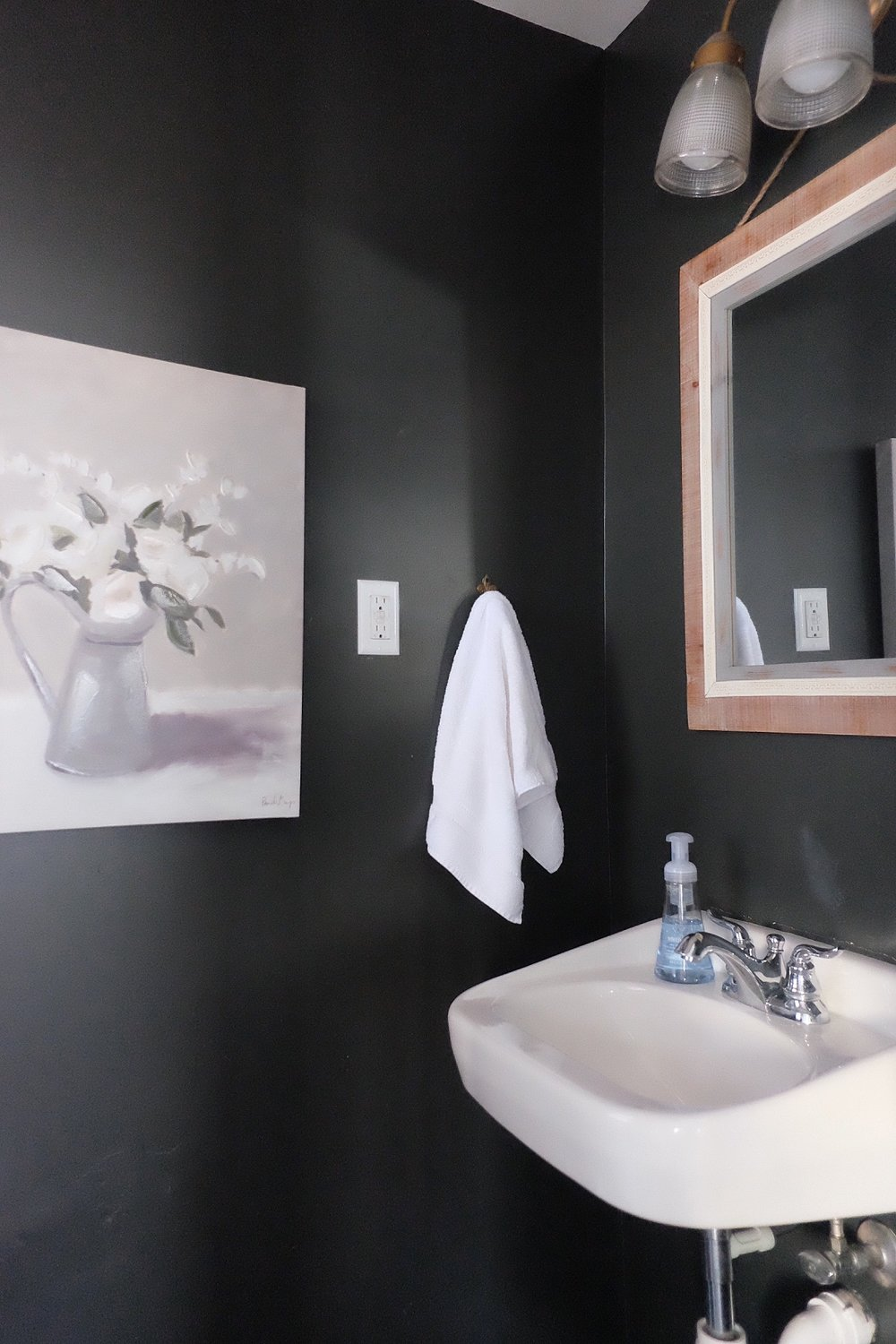 1/2 bath - Painted walls a dark color (SW Peppercorn) and added wood accents to warm it up.